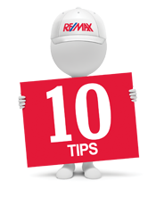 remax man holding a sign with the number ten on it